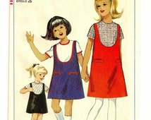 "A Collarless, Short Sleeve, Back Button Blouse, and A-Line, Scoop Neckline Jumper Pattern: Girls Size 8, Breast 26"" • Simplicity 6288"