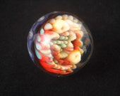 Large glass marble. Beautiful color. Latty and dot implosion, wrap and rake background