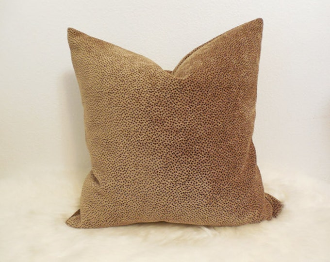 golden tan pillow cover with small brown spots