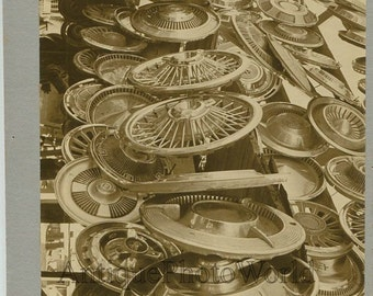Car wheel hubs vintage art photo by W. Zinsmeister