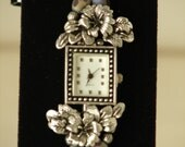Silver Tone Metal Flowers and Butterflies with Glass Beads Watch