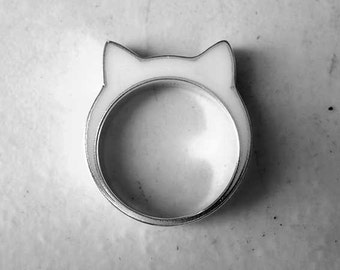 Handmade sterling silver and white resin cat ears ring.