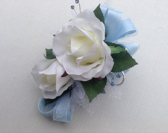 2 Piece wrist corsage and boutonniere in white roses with light blue ribbon