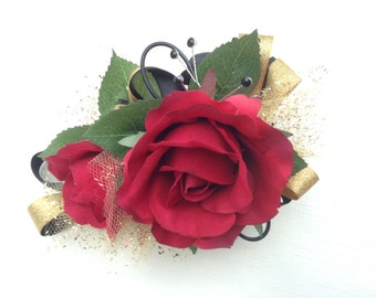2 piece wrist corsage and boutonniere in red roses with black and gold ribbon
