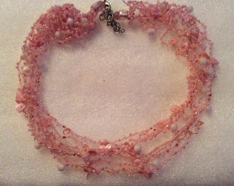 Very nice vintage silver tone clasp pink crochet glass beads and shell in great condition