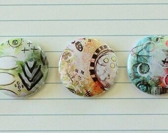 "3 badges 1 ""Mixed Media (design Neija Zeugme)"