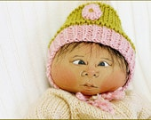 cloth soft sculptured eskimo baby doll, jointed, 16 inches