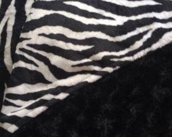 Sale, I took 10 dollars off this Tween/teen/toddler blanket with a zebra print shannon brand cuddle a black swirl/rosebud .