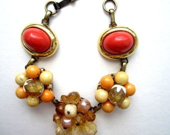 Repurposed /Upcycled Vintage Orange and Coral Colored Earrings in an Antiqued Bronze Bracelet, Eco Chic Bracelet. Orange Bracelet.