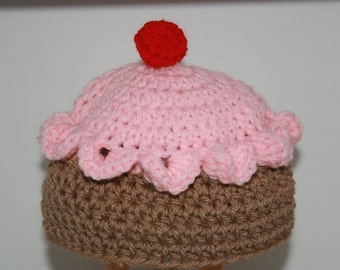 Cupcake Iced Bun 'Inspired' Crochet Beanie Hat. Pink frosting and cherry on top.