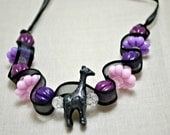 Kid's giraffe necklace. Pink and purple beads and black ribbon. Ships free.
