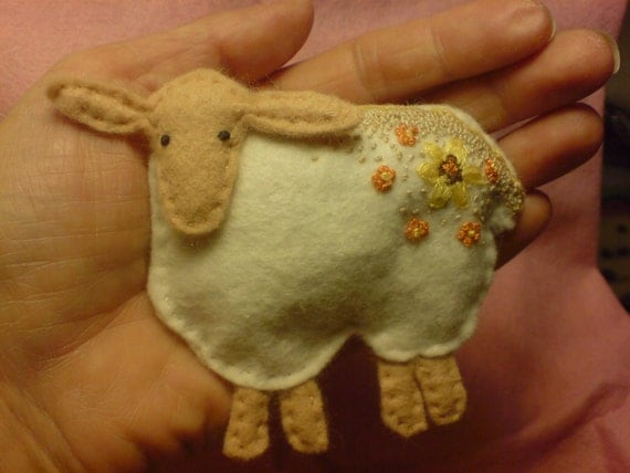 Embroidered felt sheep in autumn colours