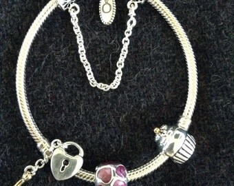 Authentic Pandora bracelet with mixed metals beads and safety chain