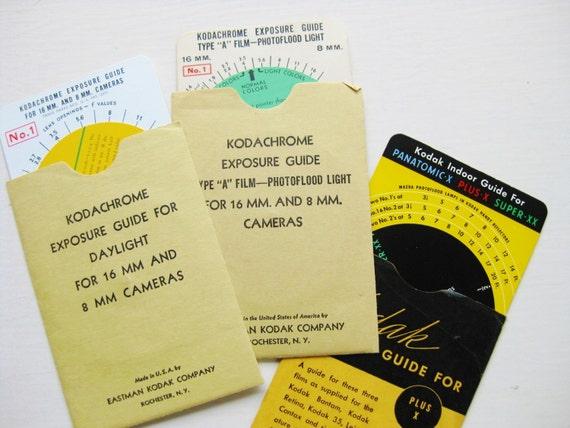 Three Kodak exposure guides. 1950s.  Guide wheels. 16mm, 8 mm, Plus-X, Super-XX, Panatomic-X