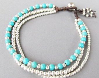 Multi Strand Turquoise Bracelet with Silver Colour Bead