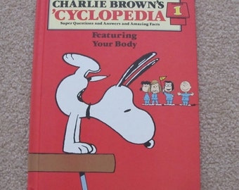 Vintage 1980 Charlie Brown's 'Cyclopedia Volume 1 Published by Funk & Wagnalls, Inc. Encyclopedia Hardcover Reference Book