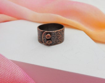 Size 8 Etched copper wrapped and riveted band ring