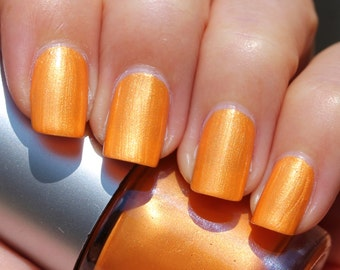 Sunet Franken Nail Polish - Bright orange color with gold shimmer