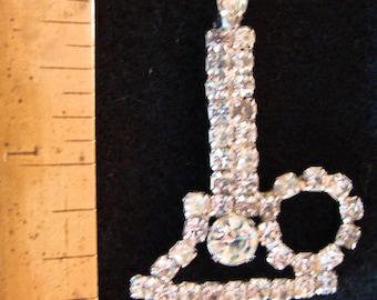Vintage clear rhinestone candle brooch