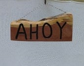 Crafted From Cedar this AHOY Sign welcomes people with a nautical flair