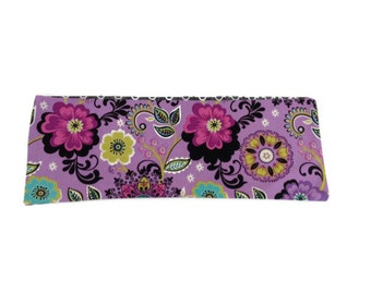 Microwaveable Flax Seed Heating Pad with Bright Flowers on Purple background