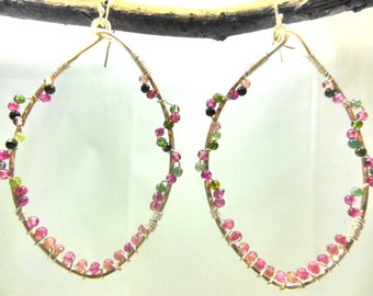 Oval sterling silver wire wrapped hoops with seed tourmaline gemstones