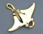Gold Manta Ray pendant set with natural diamonds for its eyes.