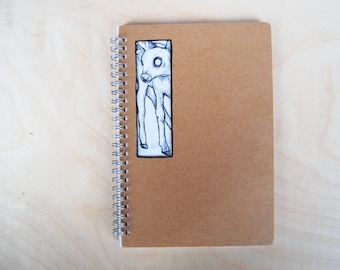 Notebook with cutout and deer / fawn drawing