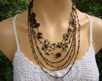 7 STRAND beaded bib necklace.  Classic brown metal discs and beaded necklace.  Great for any occasion or outfit.