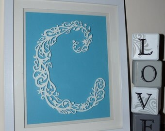 individual hand cut paper initial letter C