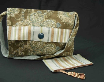 Adult teal blue messenger bag styled purse with long shoulder strap and separate zippered clutch bag