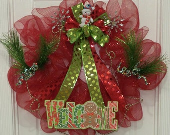 REDUCED PRICE! Christmas wreath made with red deco mesh ribbon accented with green and red bow featuring a cute snowman