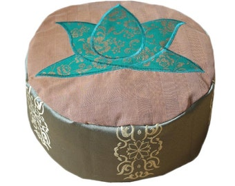 Meditation cushion. Green with golden lotus flower motif on okergeruite surface. Side green with woven pattern.