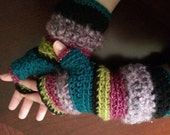These fleece lined fingerless gloves have less chance of getting lost because you won't want to take them off. / teal,purples,black & bling.