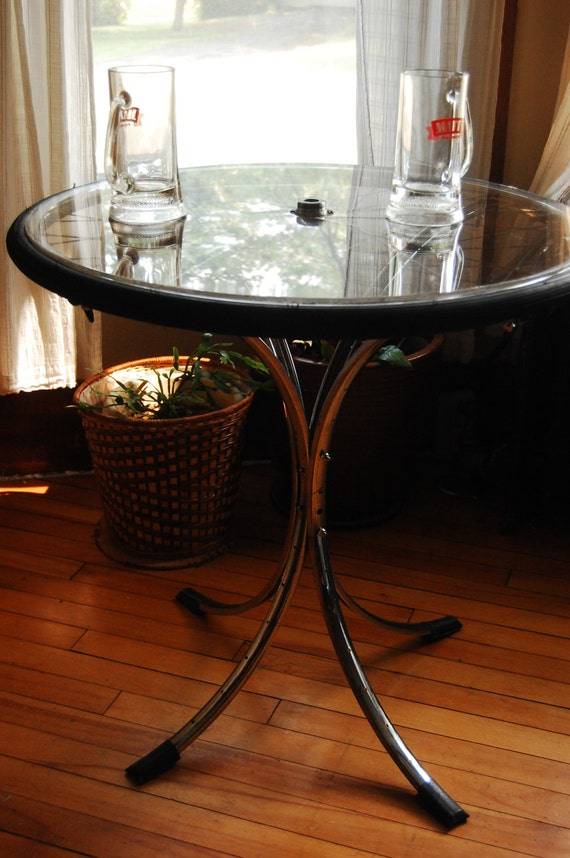 Items similar to upcycled bike wheel table on etsy for Bicycle wheel table