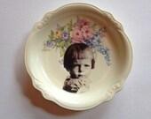 feisty little girl - altered vintage plate