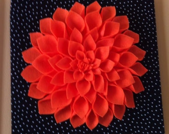 Orange felt dahlia in black and white polka dot background 12x12 inches