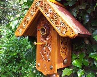 bird house with carvings