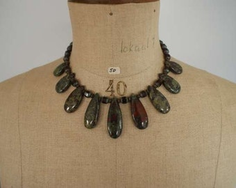 Necklace of semi-precious stone dragon blood jasper (Oval) with glass beads.