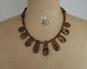 Necklace of 9 multicolor Picasso jasper pendants, copper-colored spacers, oval tiger eye