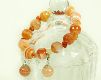 Faceted agate and carnelian gemstone bracelet and earrings set.