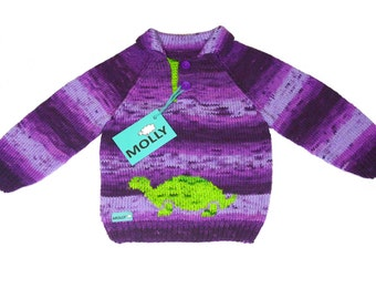 Violet knitted sweater with green turtle in size 98, 2-2,5 years old