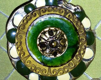 Beautifully handcrafted from rhinestones and buttons, some old, some newer