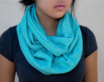 Turquoise colored knitted infinity scarf (cowl)