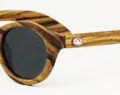 Runabout style handcrafted Zebrawood wood sunglasses with premium polarized lenses