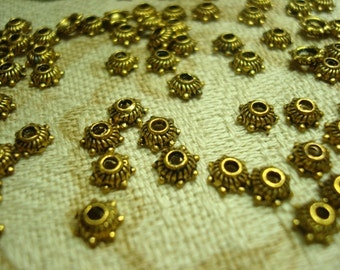 144 Adorable Little Tiny Gold Finish Wagon Wheel Caps.  6 x 2mm.   *USPS Ship Rates from Oregon*