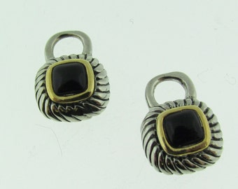 Silver and gold tone earring dangles.
