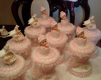 these are some of the baby girl babshower centerpeices they look amazing at baby showers.