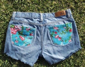 upscaled denim shorts with floral back pockets and studded front pockets