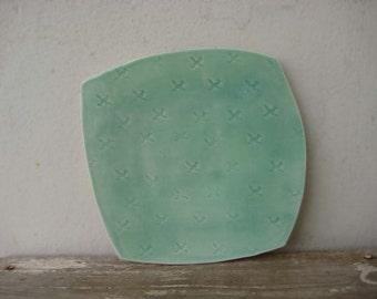 "Porcelain dinner plate with roadrunner stamp pattern in green celadon glaze, 10"" x 10"""